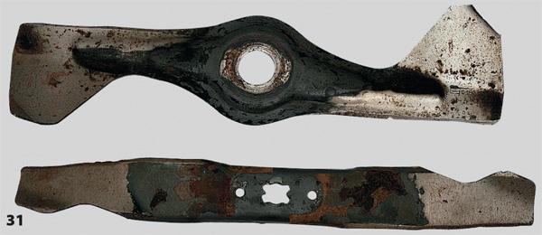 На фото видны не только зарубы на режущих кромках, но также износ противоположной кромки, которая создает воздушный поток