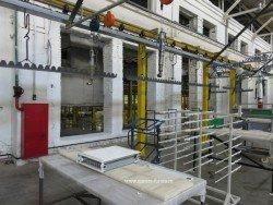 Покрашенные радиаторы Buderus снимают с конвейера и упаковывают